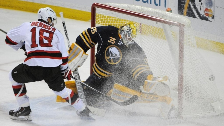 New Jersey Devils Steve Bernier (18) scores on Buffalo Sabres Anders Lindback (35) during the second period of an NHL hockey game Friday, March 20, 2015, in Buffalo, N.Y. (AP Photo/Adam Wiepert)