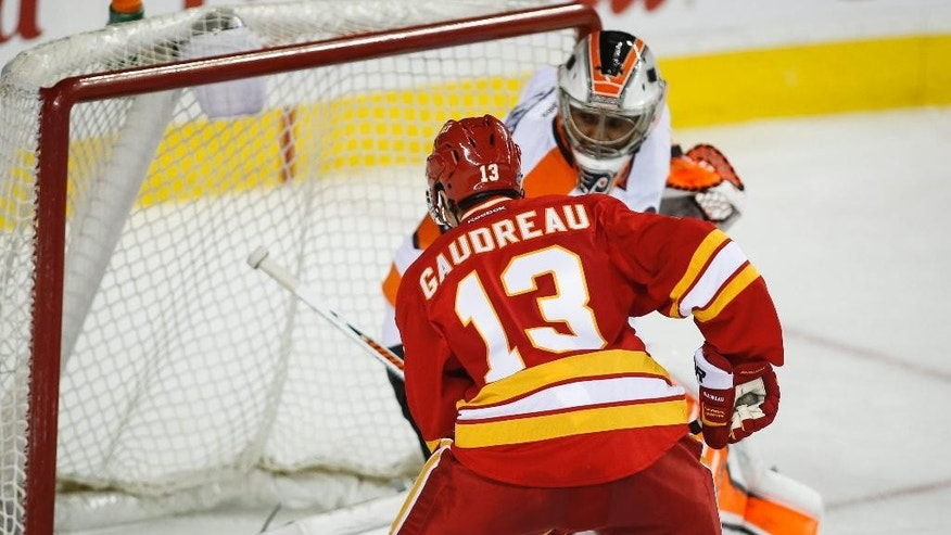 Philadelphia Flyers goalie Ray Emery lets in a goal from Calgary Flames Johnny Gaudreau during third period of an NHL hockey game in Calgary, Alberta, Thursday, March 19, 2015. (AP Photo/The Canadian Press, Jeff McIntosh)