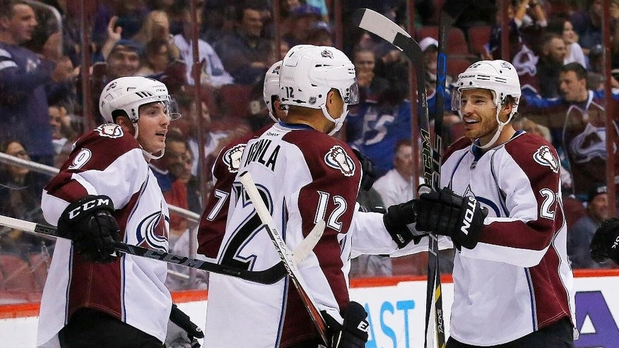 Colorado Avalanche's Jarome Iginla (12) celebrates his goal against the Arizona Coyotes with Matt Duchene (9) and Zach Redmond, right, during the first period of an NHL hockey game Thursday, March 19, 2015, in Glendale, Ariz. (AP Photo/Ross D. Franklin)