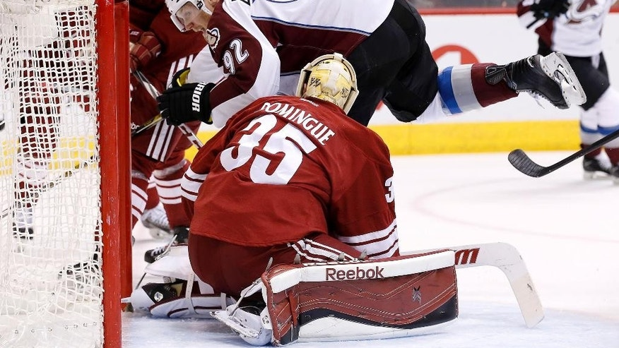 Colorado Avalanche's Gabriel Landeskog (92), of Sweden, starts to celebrate his goal against Arizona Coyotes' Louis Domingue (35) during the first period of an NHL hockey game Thursday, March 19, 2015, in Glendale, Ariz. (AP Photo/Ross D. Franklin)