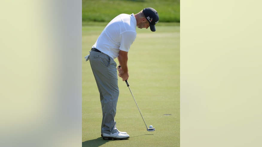 Matt Every watches his putt on the 18th green during the second round of the Arnold Palmer Invitational golf tournament in Orlando, Fla., Friday, March 20, 2015.(AP Photo/Phelan M. Ebenhack)