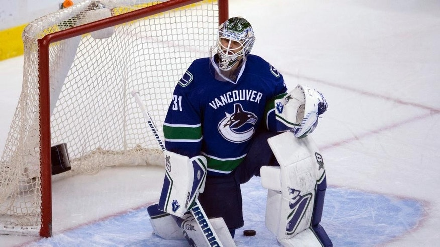 Vancouver Canucks goalie Eddie Lack (31) reacts after being scored on by Columbus Blue Jackets center Marko Dano (56) during the second period of an NHL hockey game in Vancouver, British Columbia, Thursday, March. 19, 2015. (AP Photo/The Canadian Press, Jonathan Hayward)