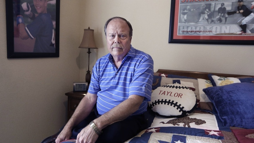 March 17, 2015: Don Hooton posses for a photo in a room with remembrances of his late son Taylor Hooton at his home.