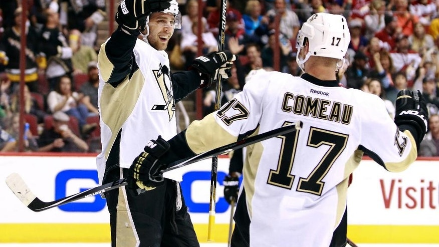 Pittsburgh Penguins' Brandon Sutter, left, celebrates with teammate Blake Comeau (17) after his second period goal against the Arizona Coyotes during an NHL hockey game, Saturday, March  21, 2015, in Glendale, Ariz. (AP Photo/Ralph Freso)