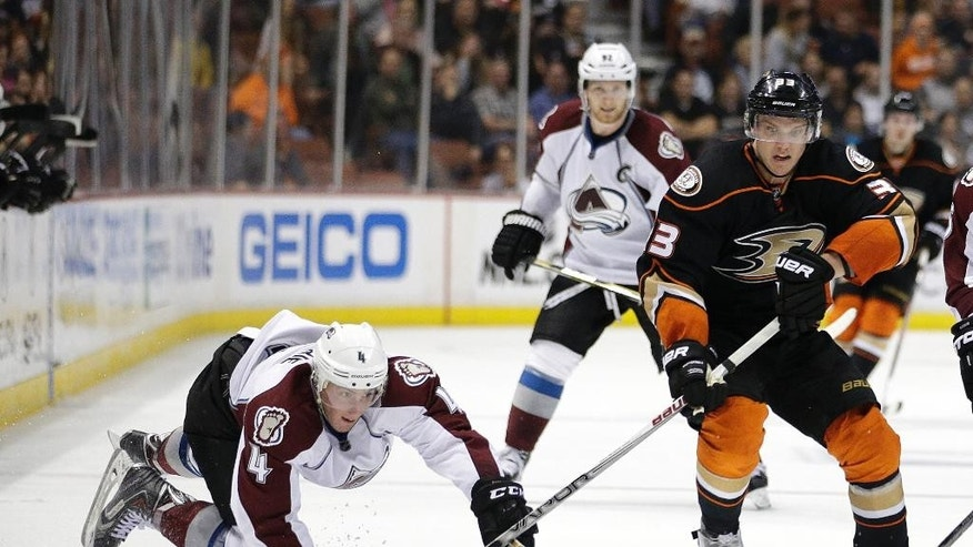 Colorado Avalanche's Tyson Barrie, left, dives to get the puck from Anaheim Ducks' Jakob Silfverberg, of Sweden, during the second period of an NHL hockey game, Friday, March 20, 2015, in Anaheim, Calif. (AP Photo/Jae C. Hong)