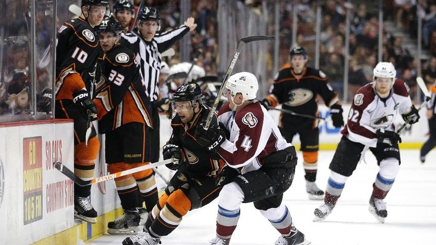 Colorado Avalanche's Tyson Barrie, center right, shoves Anaheim Ducks' Andrew Cogliano during the second period of an NHL hockey game, Friday, March 20, 2015, in Anaheim, Calif. (AP Photo/Jae C. Hong)