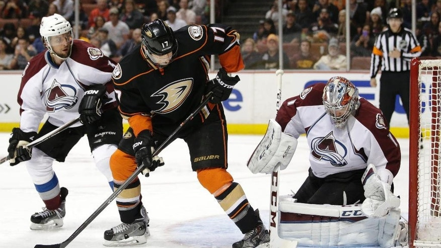 Colorado Avalanche goalie Semyon Varlamov, right, of Russia, makes a save as Anaheim Ducks' Ryan Kesler watches during the second period of an NHL hockey game, Friday, March 20, 2015, in Anaheim, Calif. (AP Photo/Jae C. Hong)