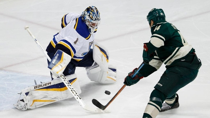 Minnesota Wild right wing Chris Stewart (44) shoots the puck under St. Louis Blues goalie Brian Elliott (1) to score during the first period of an NHL hockey game in St. Paul, Minn., Saturday, March 21, 2015. (AP Photo/Ann Heisenfelt)