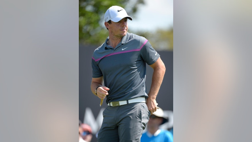Rory McIlroy, of Northern Ireland, waits to walk down the 10th fairway after teeing off during the third round of the Arnold Palmer Invitational golf tournament in Orlando, Fla., Saturday, March 21, 2015.(AP Photo/Phelan M. Ebenhack)
