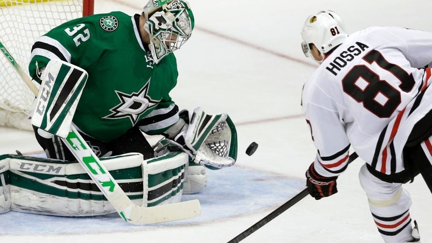 Dallas Stars goalie Kari Lehtonen (32) blocks a shot against Chicago Blackhawks right wing Marian Hossa (81) during the second period of an NHL hockey game Saturday, March 21, 2015, in Dallas. (AP Photo/LM Otero)