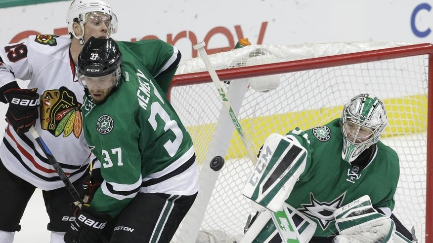 Dallas Stars goalie Kari Lehtonen (32) and teammate Patrik Nemeth (37) defend the goal against Chicago Blackhawks center Jonathan Toews (19) during the second period of an NHL hockey game Saturday, March 21, 2015, in Dallas. (AP Photo/LM Otero)