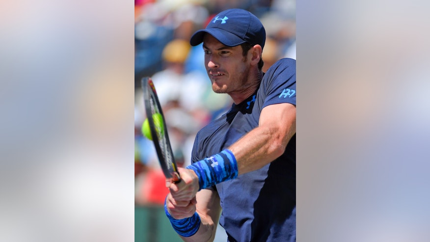 Andy Murray, of Great Britain, returns to Novak Djokovic, of Serbia, during their semifinal match at the BNP Paribas Open tennis tournament, Saturday, March 21, 2015, in Indian Wells, Calif. (AP Photo/Mark J. Terrill)