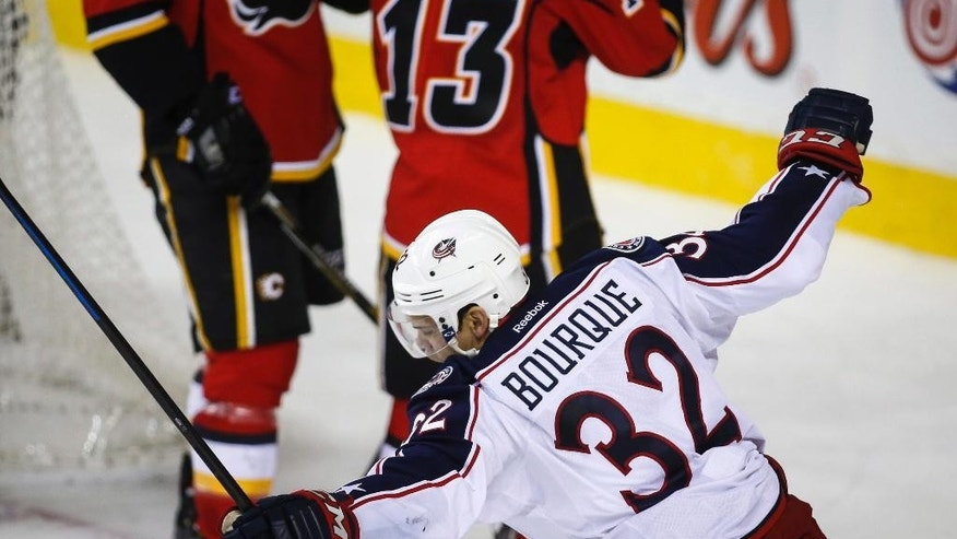 Columbus Blue Jackets Rene Bourque celebrates scoring the game-winning goal against the Calgary Flames during overtime in an NHL hockey game, Saturday, March 21, 2015 in Calgary, Alberta. (AP Photo/The Canadian Press, Jeff McIntosh)