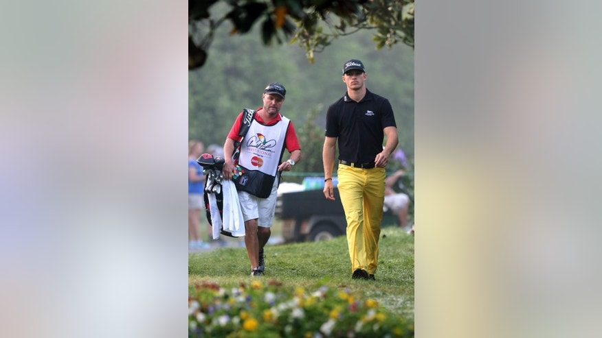 Morgan Hoffmann, right, walks to the second tee with his caddie during the second round of the Arnold Palmer Invitational golf tournament in Orlando, Fla., Friday, March 20, 2015. (AP Photo/Reinhold Matay)