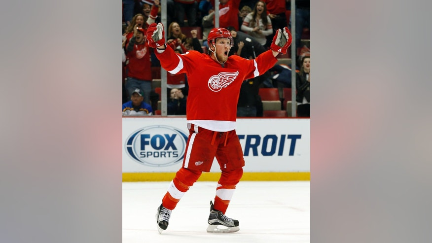 Detroit Red Wings' Justin Abdelkader (8) celebrates after scoring against the St. Louis Blues in overtime of an NHL hockey game in Detroit, Sunday, March 22, 2015. Detroit won 2-1. (AP Photo/Paul Sancya)