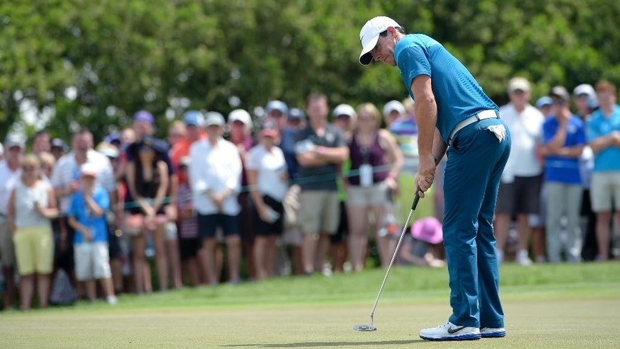 Rory McIlroy, of Northern Ireland, watches his putt on the first green during the final round of the Arnold Palmer Invitational golf tournament in Orlando, Fla., Sunday, March 22, 2015. (AP Photo/Phelan M. Ebenhack)