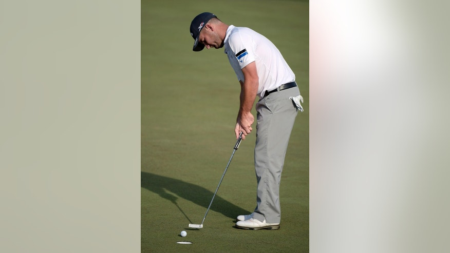 Matt Every watches his putt on the 18th green during the third round of the Arnold Palmer Invitational golf tournament in Orlando, Fla., Saturday, March 21, 2015.(AP Photo/Phelan M. Ebenhack)