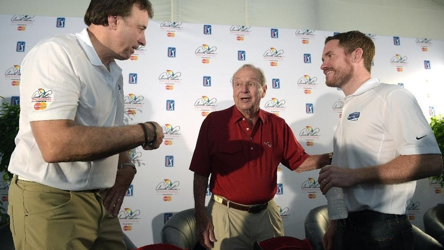 Actor Kevin Nealon, left, Arnold Palmer, center, and NASCAR driver Brian Vickers chat after a news conference during a pro-am of the Arnold Palmer Invitational golf tournament in Orlando, Fla., Wednesday, March 18, 2015.(AP Photo/Phelan M. Ebenhack)