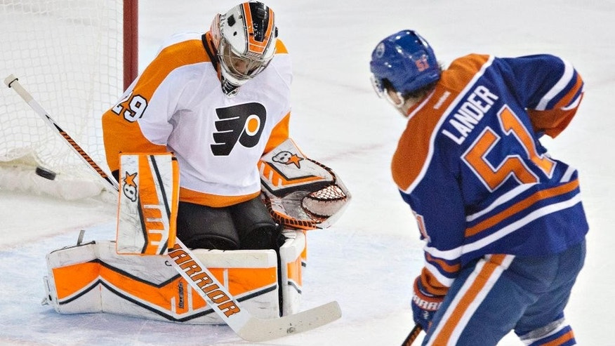 Philadelphia Flyers goalie Ray Emery (29) makes a save against Edmonton Oilers' Anton Lander (51) during the second period of an NHL hockey game Saturday, March 21, 2015, in Edmonton, Alberta. (The Canadian Press, Jason Franson)