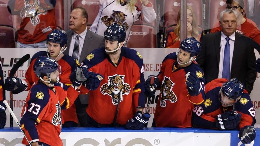 Florida Panthers center Brandon Pirri (73) is congratulated by teammates after scoring the game-winning goal against the Boston Bruins in a shootout of an NHL hockey game in Sunrise, Fla., Saturday, March 21, 2015. The Panthers won 2-1. (AP Photo/Alan Diaz)