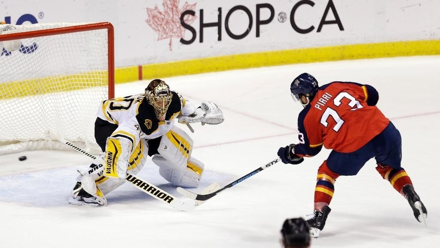 Florida Panthers center Brandon Pirri (73) scores the game winning goal against Boston Bruins goalie Tuukka Rask (40) during a shootout in an NHL hockey game in Sunrise, Fla., Saturday, March 21, 2015. The Panthers won 2-1. (AP Photo/Alan Diaz)