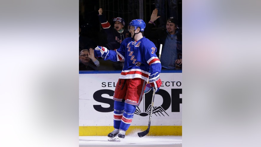 New York Rangers' Derek Stepan celebrates after scoring during the second period of the NHL hockey game against the Anaheim Ducks, Sunday, March 22, 2015, in New York. (AP Photo/Seth Wenig)