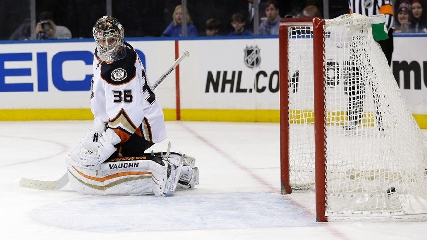 Anaheim Ducks goalie John Gibson looks back after being scored on by New York Rangers' Derek Stepan during the second period of the NHL hockey game, Sunday, March 22, 2015, in New York. (AP Photo/Seth Wenig)