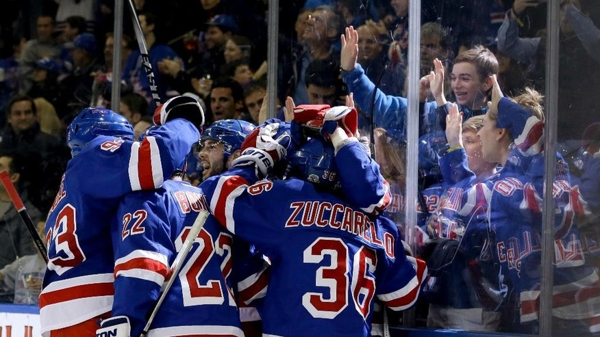 The New York Rangers celebrate a goal by J.T. Miller during the second period of the NHL hockey game against the Anaheim Ducks, Sunday, March 22, 2015, in New York. (AP Photo/Seth Wenig)