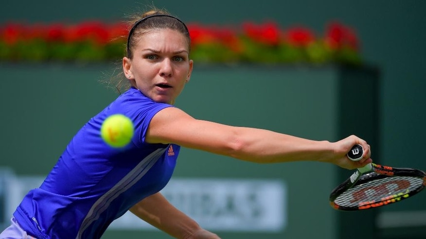 Simona Halep, of Romania, returns to Jelena Jankovic, of Serbia, during their final match at the BNP Paribas Open tennis tournament, Sunday, March 22, 2015, in Indian Wells, Calif. (AP Photo/Mark J. Terrill)