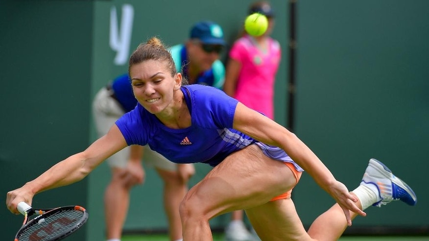 Simona Halep, of Romania, reaches for a return to Jelena Jankovic, of Serbia, during their final match at the BNP Paribas Open tennis tournament, Sunday, March 22, 2015, in Indian Wells, Calif. (AP Photo/Mark J. Terrill)