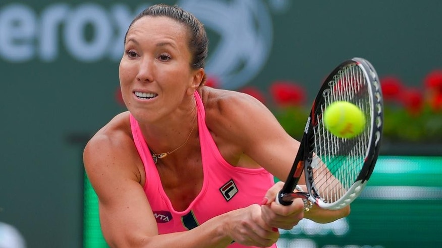 Jelena Jankovic, of Serbia, returns to Simona Halep, of Romania, during their final match at the BNP Paribas Open tennis tournament, Sunday, March 22, 2015, in Indian Wells, Calif. (AP Photo/Mark J. Terrill)
