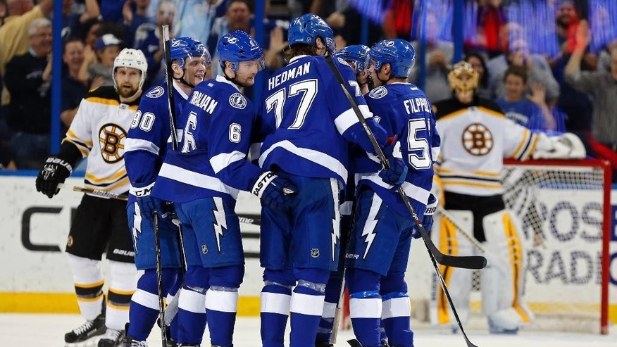 Tampa Bay Lightning's Anton Stralman (6), of Sweden, celebrates his goal with Vladislav Namestnikov (90), of Russia, Victor Hedman (77), also of Sweden, and Valtteri Filppula (51), of Finland, during the first period of an NHL hockey game against the Boston Bruins, Sunday, March 22, 2015, in Tampa, Fla. (AP Photo/Mike Carlson)
