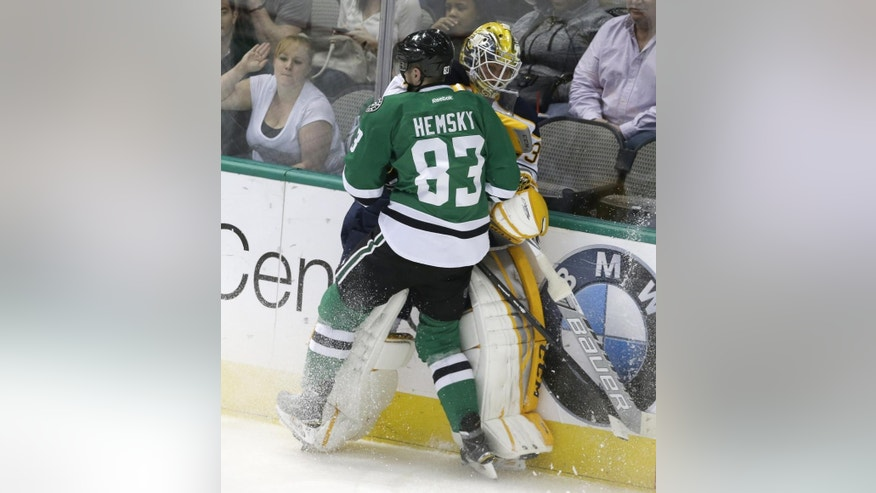 Buffalo Sabres goalie Anders Lindback is pushed into the boards by Dallas Stars right wing Ales Hemsky (83) during the second period of an NHL hockey game Monday, March 23, 2015, in Dallas. (AP Photo/LM Otero)