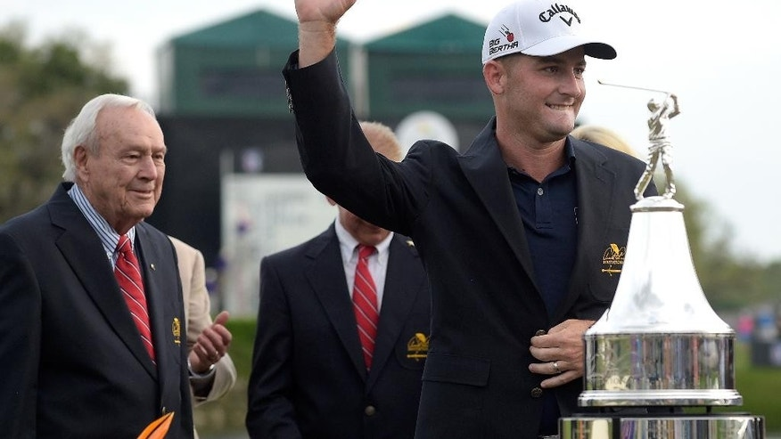 Matt Every, right, acknowledges the gallery as Arnold Palmer watches after being presented with the winner's jacket after the Arnold Palmer Invitational golf tournament in Orlando, Fla., Sunday, March 22, 2015. (AP Photo/Phelan M. Ebenhack)