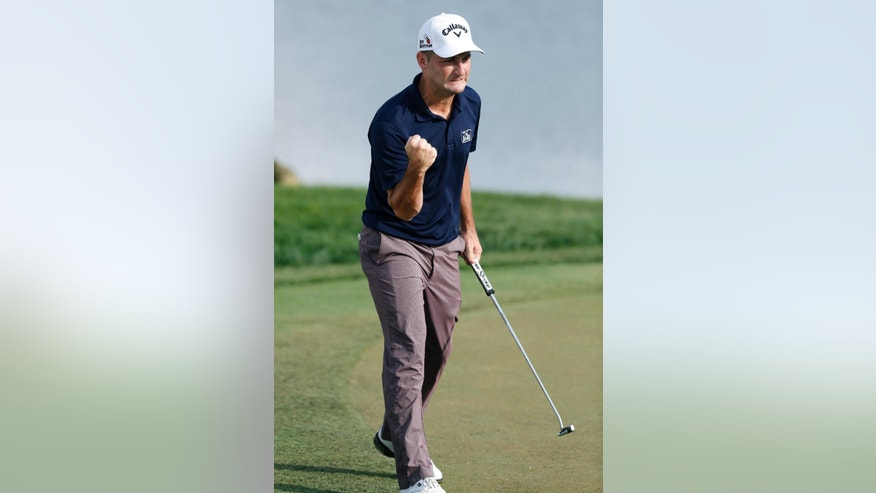 Matt Every celebrates after sinking a putt for birdie to take the lead and win the Arnold Palmer Invitational golf tournament in Orlando, Fla., Sunday, March 22, 2015. (AP Photo/Reinhold Matay)