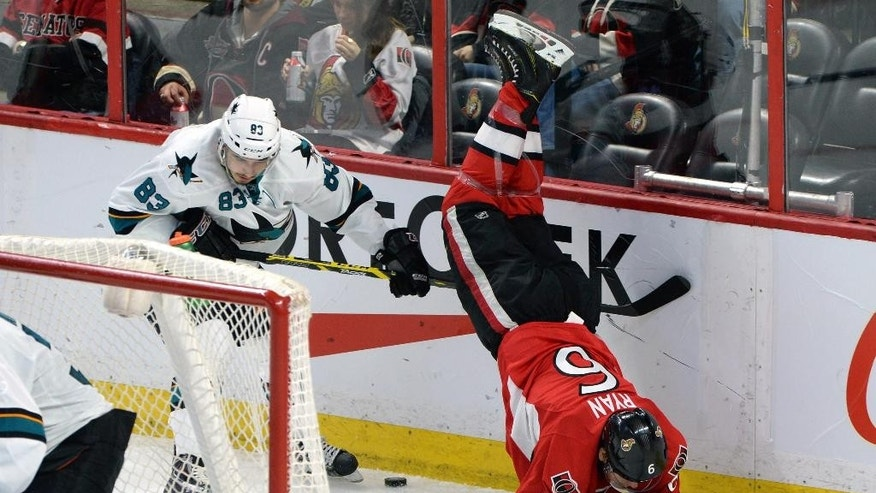 Ottawa Senators' Bobby Ryan (6) gets upended by San Jose Sharks' Matt Nieto during second period of an NHL hockey game in Ottawa, Ontario, Monday, March 23, 2015. (AP Photo/The Canadian Press, Sean Kilpatrick)