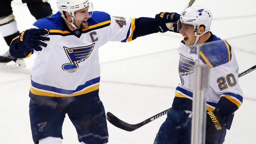 St. Louis Blues' Alexander Steen (20) celebrates his overtime goal with David Backes (42) during an NHL hockey game against the Pittsburgh Penguins in Pittsburgh on Tuesday, March 24, 2015. The Blues won 3-2 in overtime. (AP Photo/Gene J. Puskar)