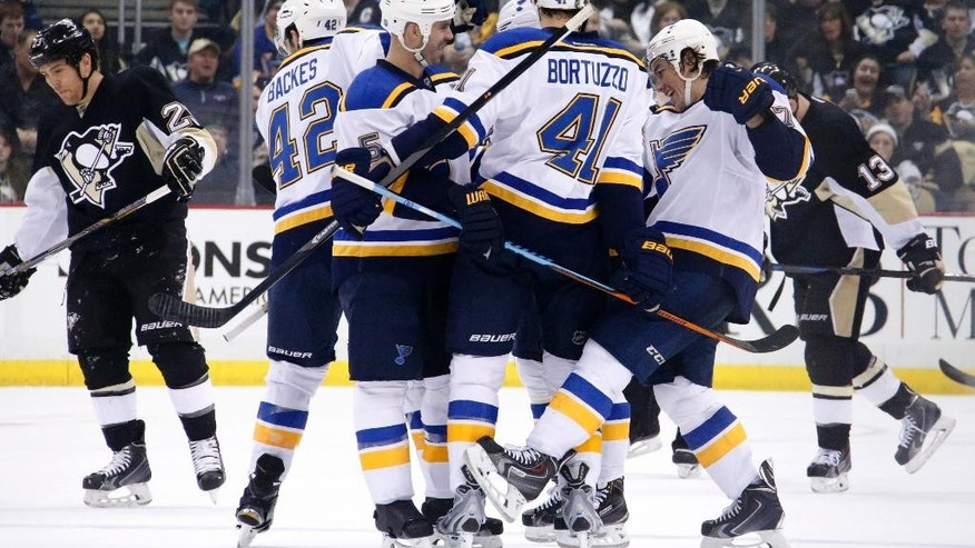 St. Louis Blues' Robert Bortuzzo (41) celebrates his goal with teammates during the second period of an NHL hockey game against the Pittsburgh Penguins in Pittsburgh on Tuesday, March 24, 2015. (AP Photo/Gene J. Puskar)