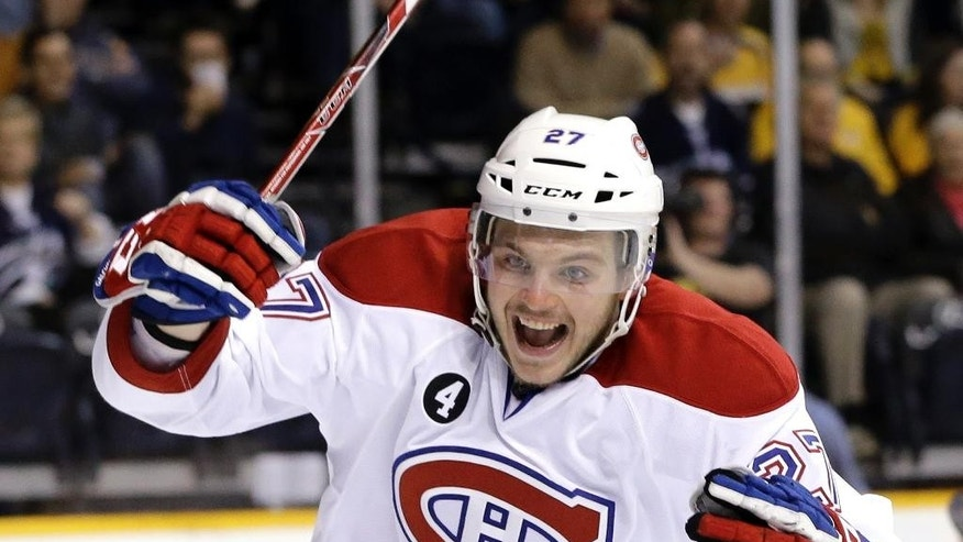 Montreal Canadiens center Alex Galchenyuk celebrates a goal scored by teammate Brendan Gallagher against the Nashville Predators in the second period of an NHL hockey game Tuesday, March 24, 2015, in Nashville, Tenn. (AP Photo/Mark Humphrey)