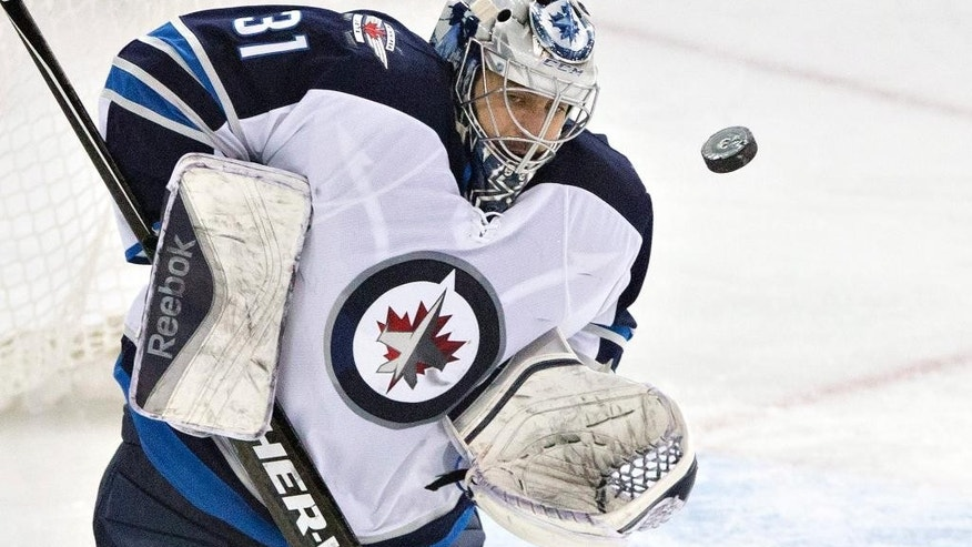 Winnipeg Jets goalie Ondrej Pavelec (31) makes a save against the Edmonton Oilers during the second period of an NHL hockey game Monday, March 23, 2015, in Edmonton, Alberta. (AP Photo/The Canadian Press, Jason Franson)