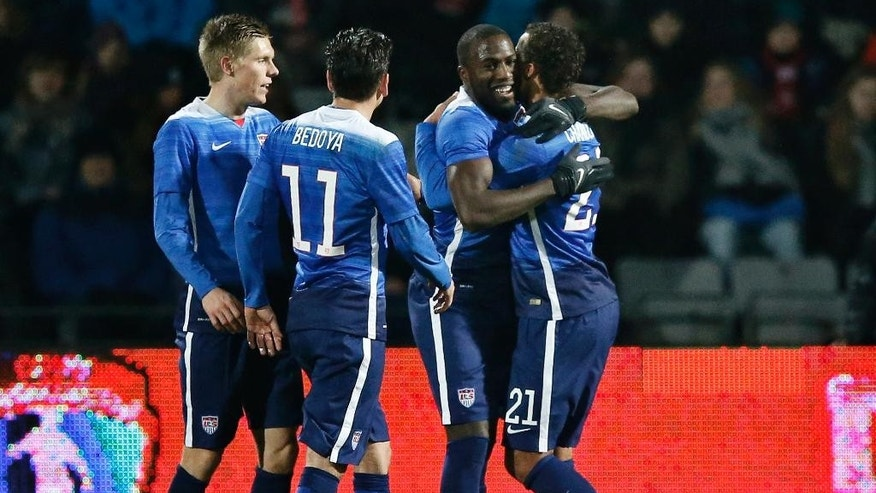 US players, Alejandro Bedoya, Jozy Altidore and Timothy Chandler celebrate their goal against Denmark during a friendly soccer match at NRGI Stadium in Aarhus, Denmark, Wednesday March 25, 2015. (AP Photo/POLFOTO, Jens Dresling)  DENMARK OUT