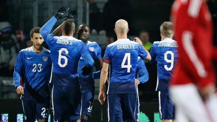 Jozy Altidore of the US, center facing, celebrates scoring against Denmark with teammates Fabian Johnson, left, John Brooks, Michael Bradley and Aron Johannsson during a friendly soccer match at NRGI Stadium in Aarhus, Denmark, Wednesday March 25, 2015. (AP Photo/POLFOTO, Jens Dresling)  DENMARK OUT