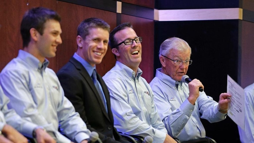 "FILE - In this Aug. 19, 2014, file photo, team owner Joe Gibbs, right, speaks as drivers Daniel Suarez, left, Carl Edwards, second from left, and team president J.D. Gibbs, second from right, laugh during a news conference at Joe Gibbs Racing's headquarters in Huntersville, N.C.  Joe Gibbs Racing President J.D. Gibbs is undergoing treatment for ""symptoms impacting areas of brain function."" The 46-year-old Gibbs is the oldest son of team owner Joe Gibbs, the Hall of Fame coach who won three Super Bowls with Washington. The team said in a statement on Wednesday, March 25, 2015,  that J.D. Gibbs has undergone a series of tests since experiencing ""speech and processing issues."" (AP Photo/Chuck Burton, File)"