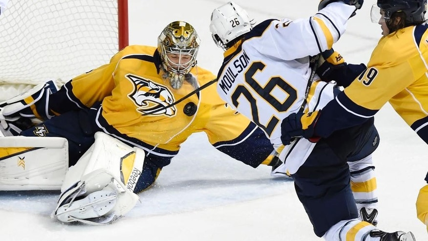 Nashville Predators goalie Pekka Rinne (35), of Finland, takes a shot to the chest by Buffalo Sabres left wing Matt Moulson (26) in the third period of an NHL hockey game Saturday, March 21, 2015, in Nashville, Tenn. (AP Photo/Sanford Myers)