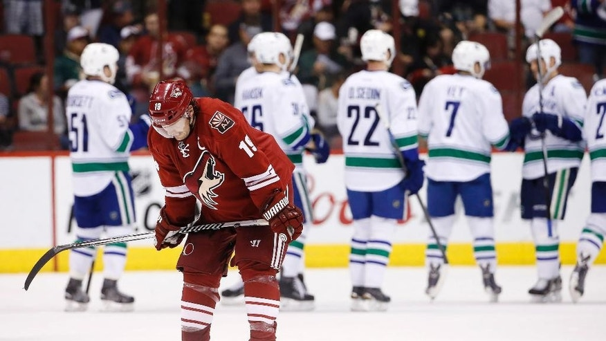 Arizona Coyotes' Shane Doan (19) skates off the ice after an NHL hockey game loss to the Vancouver Canucks Sunday, March 22, 2015, in Glendale, Ariz.  The Canucks defeated the Coyotes 3-1. (AP Photo/Ross D. Franklin)