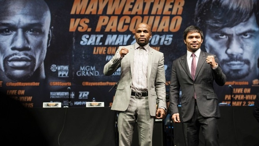 Mayweather and Pacquiao after a news conference Wednesday, March 11, 2015, in Los Angeles.