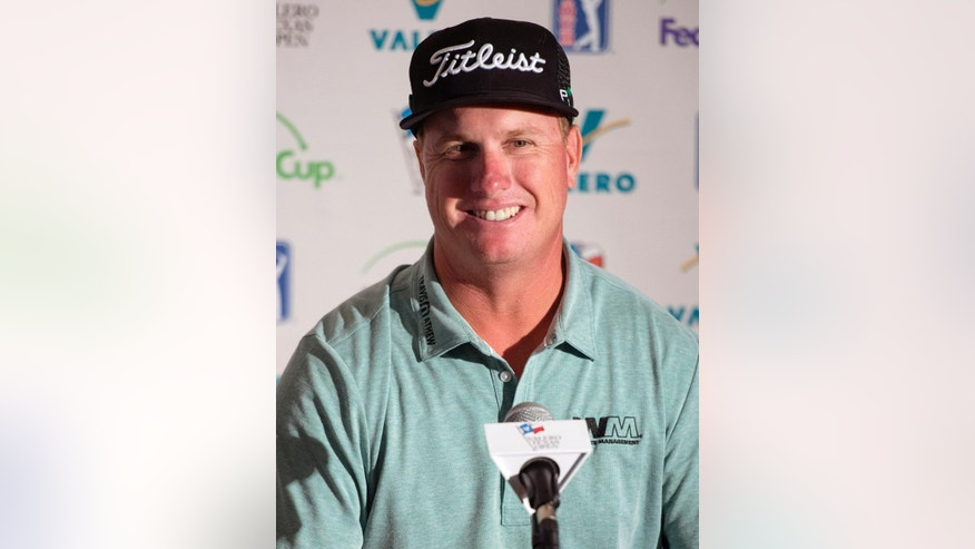 Charley Hoffman speaks at a news conference after the first round of the Valero Texas Open golf tournament, Thursday, March 26, 2015, in San Antonio. Hoffman finished the round in first place at five under par. (AP Photo/Darren Abate)