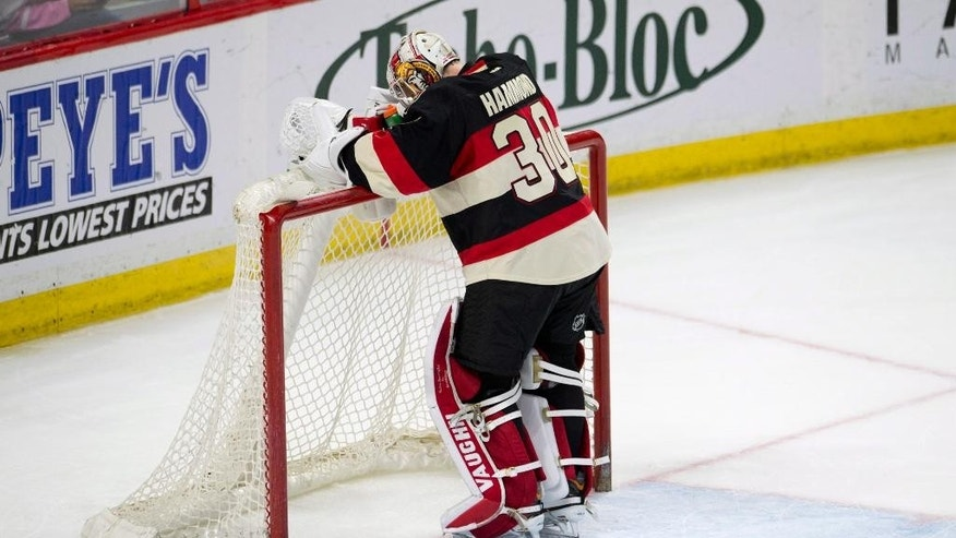 Ottawa Senators goalie Andrew Hammond stands in his crease after allowing the fifth New York Rangers goal during the second period of an NHL hockey game Thursday, March 26, 2015, in Ottawa, Ontario. (AP Photo/The Canadian Press, Adrian Wyld)