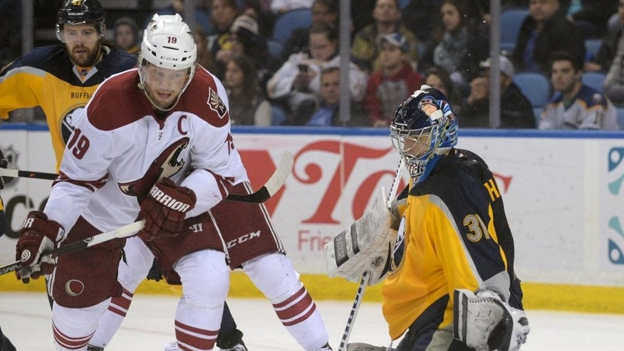 Arizona Coyotes right winger Shane Doan (19) eyes a rebound from Buffalo Sabres goaltender Matt Hackett (31) during the second period of an NHL hockey game Thursday, March 26, 2015, in Buffalo, N.Y. (AP Photo/Gary Wiepert)