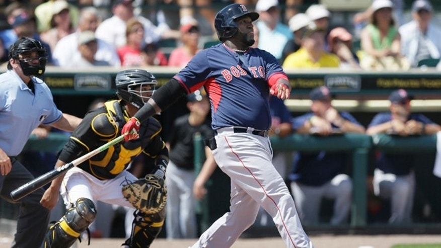 Boston Red Sox designated hitter David Ortiz watches his three-run home run clear the center field wall during the third inning of a spring training exhibition baseball game against the Pittsburgh Pirates in Bradenton, Fla., Thursday, March 12, 2015. The Red Sox defeated the Pirates 5-1. (AP Photo/Carlos Osorio)